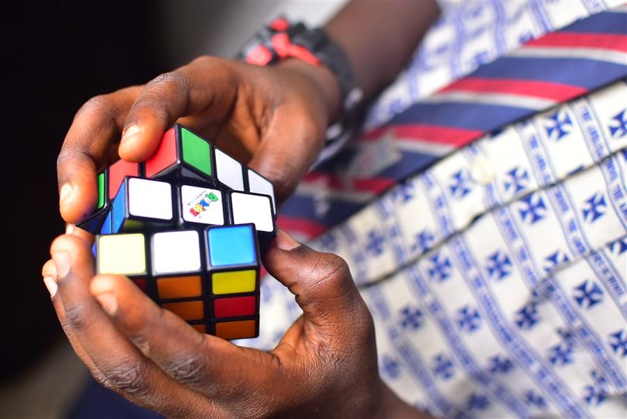 Smart Boy Solving A Rubiks Cube